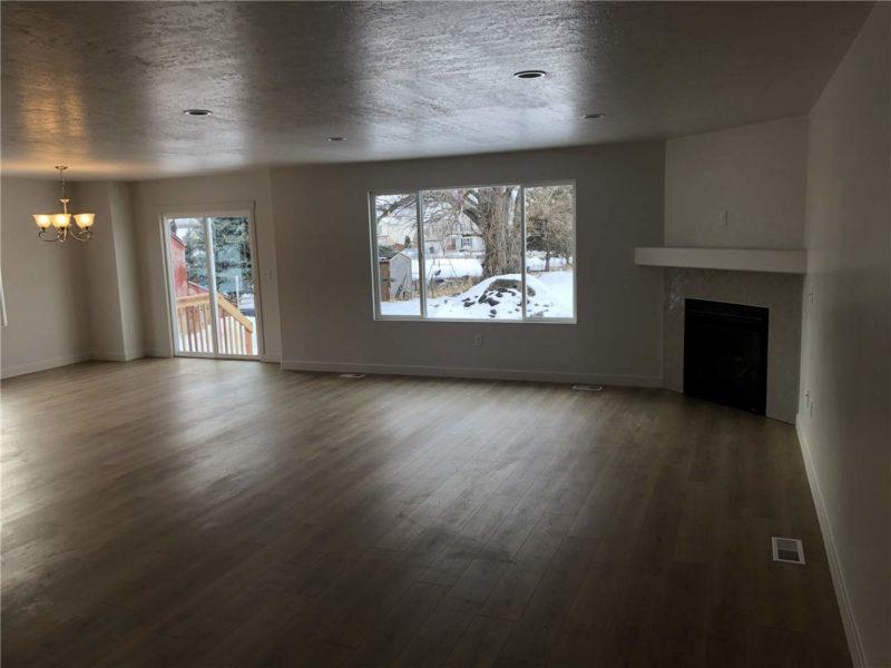 Living room with hardwood floors in new rental home listing in Heber City, UT