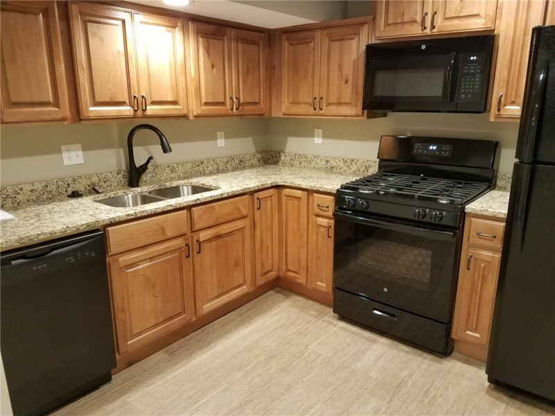 Updated kitchen with wood cabinets, granite countertops, and new appliances