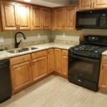 Updated kitchen with wood cabinets, granite countertops, and new appliances in Heber City studio apartment listing